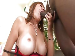 Busty mom Desi Foxx gets it from a large black schlong