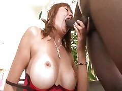 Busty mom Desi Foxx gets it from a large black schlong