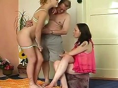 Amateur threesome party where old and fat daddy fucks 2 gals