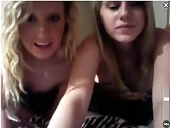 A couple of cute college coeds doing some webcam from a hotel room.  They hide behind a blanket for awhile, but start showing their gorgeous tits.  Then they stand up and lower their bikini bottoms to flash their pussies.