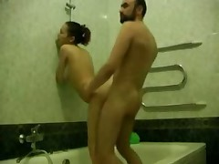 Bearded dude washes his hot girlfriend in bathroom, soaping her sweet hole and then strips to fuck her right there.
