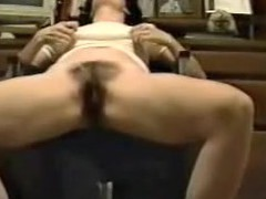 This is a great movie of a woman finger fucking herself at the office. The camera is sitting on the ground looking up at the girl sitting in a chair. You can hear her moaning when that babe makes herself cum.