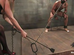 Domina Harmony doesn't allows men to do what they want, so, with the help of her chains and all sorts of simple but efficient tools she punishes this muscled guy, first by adding clothespins on his face and then by thrashing him during the time that he's in chains. She does her job perfectly and pretty soon this fellow will be resigned enough