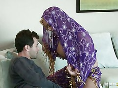 James Deen is glad by the big milk sacks of shyla stylez wearing belly dancer wardrobe. This babe is looking breathtaking in purple. Her milk sacks are groped hard by deen and licking it with passion. This babe really wants her pussy being rubbed too.