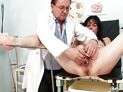 Older brunette hair hair babes with nice body and naughty breasts is sitting the gynecologist table absolutely undressed with her legs spread so that her doctor can exam the wet crack between them. He recommends her a sex-toy therapy so the treatment begins as he introduces that sex toy unfathomable in her bald vagina. This babe becomes horny and does treats her pussy with her own hands.