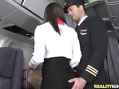 Ready for take-off captain! But previous to that, this curvy flight stewardess went down on her knees to give the pilot a blowjob! Joining the mile-high club has not at any time been this hot, especially when a beautiful brunette cabin crew strips for the captain to fondle her big ass! Bon voyage passengers!