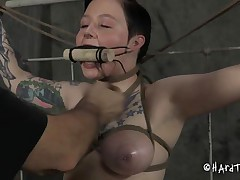 Doesn't she looks good fastened in that position and mouth gagged? We don't want her screams disturbs the executor do we? She's a angel and the way this fellow fastened and squeezed her marangos shows his experience. The fellow then inserted a fake penis attached at a stick that this guy fastened with ropes, pretty ingenious!