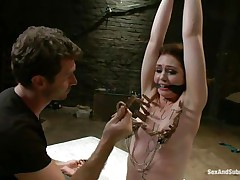 James is sick and tired of her attitude and decides to dominate her. After adding some more clothespins on her thin white body he sticks his rod between her wet lips and the way she's engulfing it makes him ease her torment and removes a few pliers, will this chick be a good angel from now on?