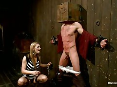 Blonde milf Tanya enjoys being Casey`s dominatrix-bitch and plays hard with his balls. This guy has his hands tied up to the wall with a box on his head. This chick can't live out of torturing his nipps and making him feel like the thrall this chab is. Casey was a bad chap and now this chab must get the right punishment! Watch how his balls tremble.