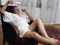 See this short haired granny masturbating in her room. She is alone and this chick needs to calm the doxy inside her who needs knobs to fuck. So this lady has only one way to survive. That is playing on her own! See how this chick is groping her own tits and then rubbing her bawdy cleft before doing a nice fingering!