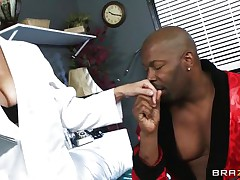 Mature busty blonde doctor arrives for checkup of her patient. Black guy starts to tempt her and offers her for ride of her lifetime. At first doctor denies but not fast and steadily comes in the charm of massive hard black cock. That guy makes her stripped and takes her to the sofa and licks her fleshy pussy.