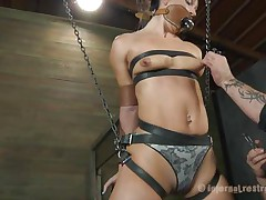 What do we have here? It's a slut, all fastened up in leather belt and hangs there waiting to be punished. She was a very bad girl and her punishment needs to be hard! Wenona has her face hole gagged and the executor rubs her twat with a vibrator. Let's watch if this guy has something to stick it in her ass