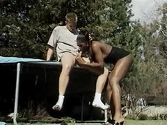 Screwing black shemale on a trampoline