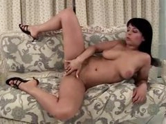 Curvy girl masturbates on the comfy sofa